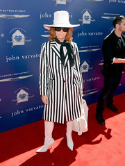 Linda Ramone showed off her unique style with this black and white striped trench coat.