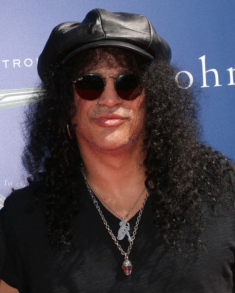 Slash's black leather newsboy cap at the Stuart House benefit was a perfect blend of cute and edgy.