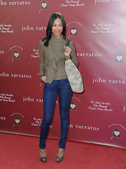 Zoe opted for a soft brown leather jacket with a decorative front ruffle for the Stuart House Benefit.