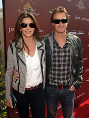 Cindy Crawford kept her look polished with a gray boucle blazer with black leather piping.