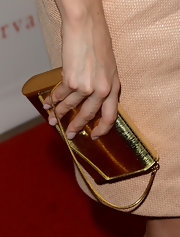 Jamie-Lynn Sigler's gold clutch was a total statement-maker—especially since it was styled with such a light blush dress.