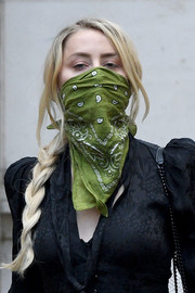 Amber Heard covered her nose and mouth with a green paisley scarf while headed to Johnny Depp's libel trial.