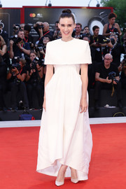 Rooney Mara went for minimalist elegance in a white capelet gown by Givenchy Couture at the Venice Film Festival screening of 'Joker.'