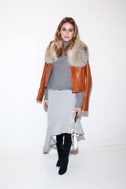 Olivia Palermo kept cozy in luxe style with a fur-accented leather jacket by Jonathan Simkhai when she attended the label's fashion show.