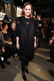 Olivia Palermo kept cozy with a long black vest at the Jonathan Simkhai fashion show.