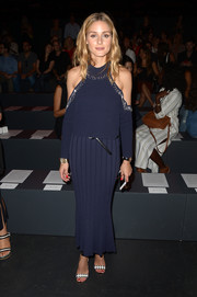 Olivia Palermo highlighted her shoulders in a navy cutout knit top by Jonathan Simkhai during the label's fashion show.
