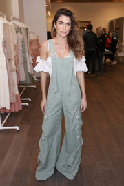 Nikki Reed teamed baggy slate-blue overalls with a flirty white cold-shoulder top for the Children's Hospital L.A. event.