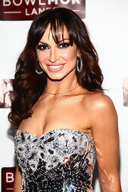 Karina Smirnoff wore her long chestnut locks in loose curls with soft bangs at the Joonbug End of the Year Bash.