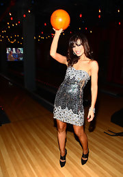 Karina Smirnoff modernized her sequined dress with pointy black cutout pumps.