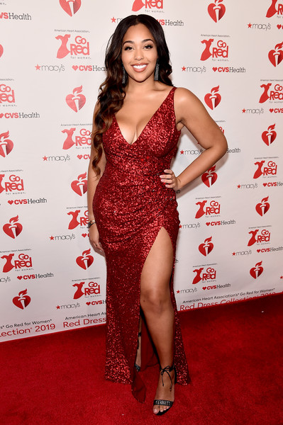 Jordyn Woods Evening Sandals [clothing,red carpet,dress,red,carpet,shoulder,cocktail dress,thigh,hairstyle,premiere,arrivals,front row,celebrity,television,relationship,clothing,american heart associations go red for women red dress collection,macys,the american heart associations go red for women red dress collection,page six,khlo\u00e9 kardashian,keeping up with the kardashians,friendship,model,celebrity,television,eylure,cheating in a relationship,page six]