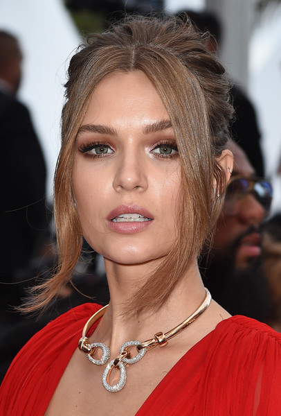Josephine Skriver Loose Bun [hair,face,hairstyle,eyebrow,lip,chin,blond,beauty,shoulder,brown hair,josephine skriver,screening,le belle epoque,cannes,france,red carpet,the 72nd annual cannes film festival]