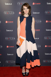 An orange hard-case clutch completed Jena Malone's perfectly coordinated ensemble.