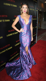 Katie Cleary worked a sexy-glam vibe in this plunging purple jacquard gown at the premiere of 'A Journey to Taiwan.'
