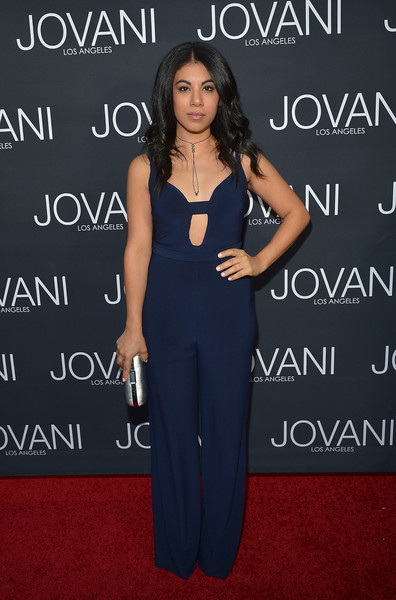 Chrissie Fit vamped it up in a navy cutout jumpsuit from Jovani's Maslavi collection during the label's LA flagship opening.