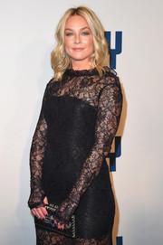 Elisabeth Rohm paired a beaded clutch with a black lace gown for the New York premiere of 'Joy.'