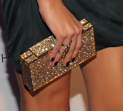 Katie definitely brought the bling with this gold and crystal encrusted clutch. Wow!