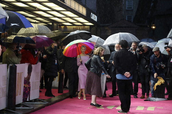 More Pics of Renee Zellweger Pumps (1 of 29) - Heels Lookbook - StyleBistro [umbrella,pink,purple,crowd,event,temple,fashion accessory,magenta,pedestrian,tourism,red carpet arrivals,judy,judy european premiere,renee zellweger,european,london,england,premiere,the curzon mayfair]