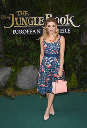 A stylish leather tote in two shades of pink finished off Ashley James' outfit.