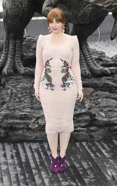 Bryce Dallas Howard showed off her curves in a ruched pink Dolce & Gabbana dress with tiger and orchid embroidery at the 'Jurassic World: Fallen Kingdom' photocall.