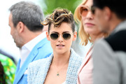 Kristen Stewart accessorized with a pair of round shades at the 2018 Cannes Film Festival jury photocall.