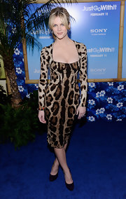 Brooklyn Decker complemented her fitted leopard print dress with purple suede pumps.