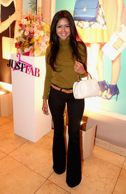 Sheryl Luke bundled up in an olive-green turtleneck for the JustFab ready-to-wear launch.