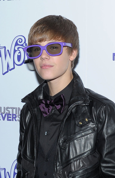 pictures of justin bieber smiling. justin bieber with glasses smiling. justin bieber purple glasses