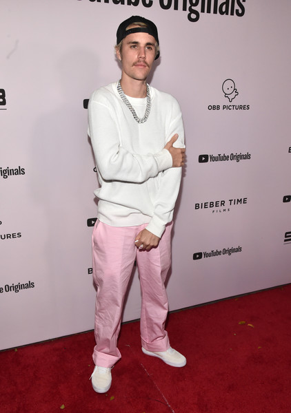 Justin Bieber Canvas Sneakers [youtube originals,youtube original,fashion,red carpet,carpet,flooring,fashion design,magenta,premiere,facial hair,red carpet,justin bieber: seasons,justin bieber,california,los angeles,regency bruin theatre,premiere,premiere,justin bieber,changes,stock photography,getty images,musician,carpool karaoke,image,photograph]