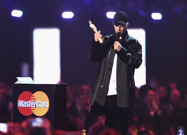 Justin Bieber Oversized Jacket [performance,entertainment,music artist,music,performing arts,concert,event,stage,song,singing,justin bieber,international male solo artist,brit awards,award,england,london,the o2 arena,brit awards]