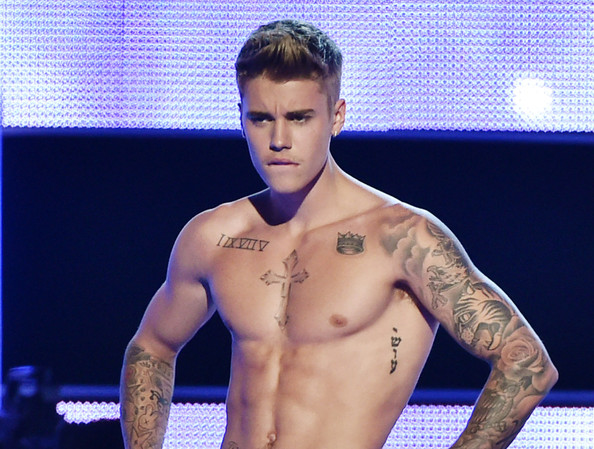 Justin Bieber Lettering Tattoo [three lions entertainment presents fashion rocks 2014 - show,barechested,muscle,chest,skin,tattoo,arm,model,abdomen,cheek,trunk,justin bieber,fashion rocks,new york city,barclays center,brooklyn,three lions entertainment]