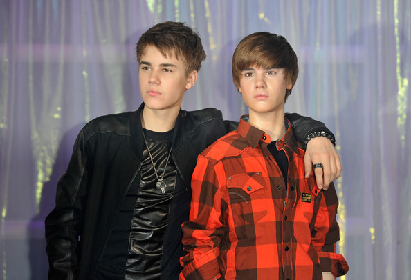 Singer Justin Bieber unveiled his wax figure at Madame Tussauds wearing two black wood Pop bracelets.