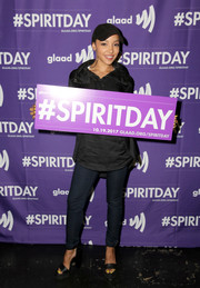 Tinashe attended the 'Believer' Spirit Day concert wearing blue skinny jeans and a loose black top.