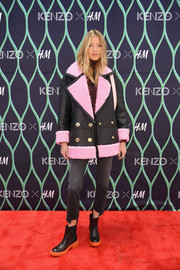 Martha Hunt tied her look together with a pair of black and orange chelsea boots, also by Kenzo x H&M.