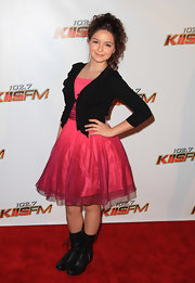 Ariel Winter gave her girly frock an edge with flat black lace up boots.