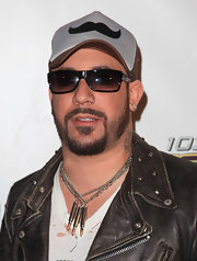 A.J. McLean showed off his silver bullet necklace while attending the Jingle Ball.