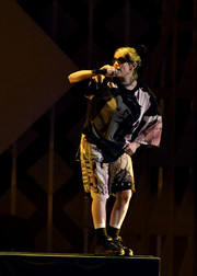 Billie Eilish paired her shirt with matching long shorts.