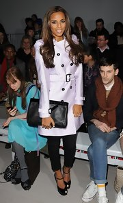 Rochelle Wiseman looked ultra-feminine in a sweet lavender trench coat.