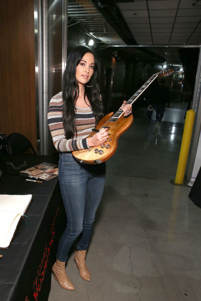 Kacey Musgraves Ankle Boots [string instrument,musical instrument,guitar,plucked string instruments,musician,guitarist,music,bass guitar,bassist,kacey musgraves,grammy,signings,los angeles,california,staples center,charities,grammy charities signings,annual grammy awards]