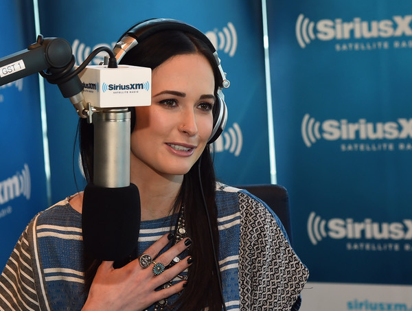 Kacey Musgraves Dark Nail Polish [microphone,audio equipment,spokesperson,electronic device,technology,journalist,media,job,gadget,kacey musgraves,buzz brainard,siriusxm the highway,nashville,tennessee,siriusxm nashville,siriusxm studios]