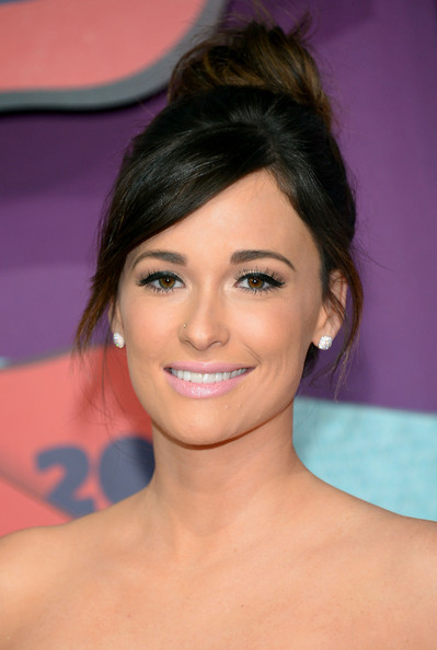 Kacey Musgraves Classic Bun [arrivals,kacey musgraves,cmt music awards,hair,face,eyebrow,hairstyle,chin,skin,eyelash,beauty,forehead,lip,bridgestone arena,nashville,tennessee]