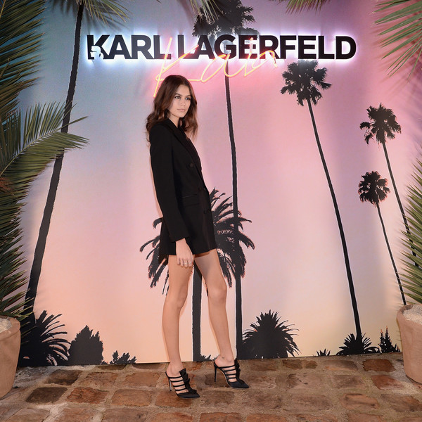 Kaia Gerber Evening Pumps [clothing,fashion,pink,leg,footwear,palm tree,tree,dress,plant,album cover,collaboration capsule collection,karl lagerfeld x,kaia gerber,photocall,paris,france,launch,kaia capsule collection launch]
