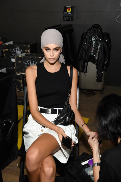 Kaia Gerber Chain Strap Bag [fashion,leg,fashion design,headgear,dress,fashion accessory,haute couture,shoe,black hair,tom ford,kaia gerber,tom ford - backstage,new york city,park avenue armory,new york fashion week,fashion show]