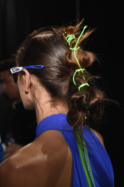 Kaia Gerber Hair Knots [hair,hairstyle,eyewear,electric blue,glasses,ear,neck,long hair,back,summer 2018 collection - backstage first looks,kaia gerber,fenty puma,new york city,rihanna spring,summer 2018 collection at park avenue armory]