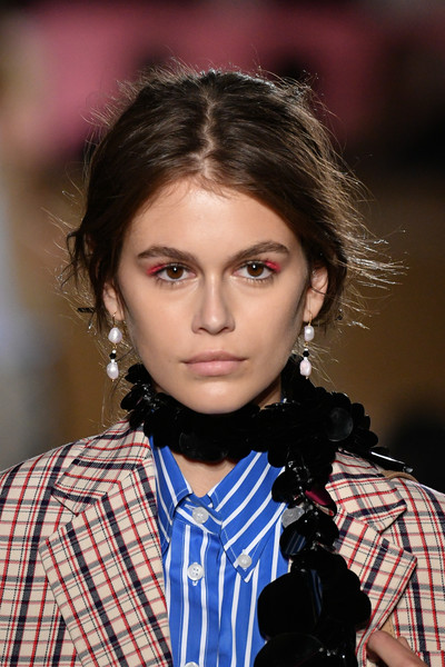 Kaia Gerber Messy Updo [kaia jordan gerber,hair,fashion,hairstyle,beauty,lip,black hair,plaid,fashion model,long hair,brown hair,prada resort 2020 collection - runway,runway,new york city,prada resort 2020 collection]