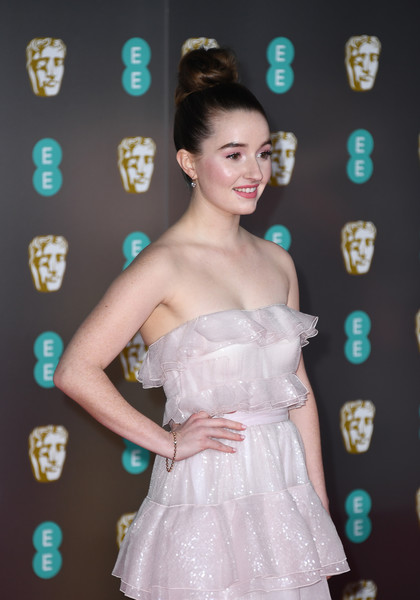 Kaitlyn Dever Gold Bracelet [clothing,shoulder,dress,hairstyle,cocktail dress,strapless dress,beauty,skin,lady,carpet,kaitlyn dever,british academy film awards,ee,england,london,royal albert hall,red carpet arrivals,kaitlyn dever,73rd british academy film awards,royal albert hall,photograph,image,celebrity,red carpet,livingly media,lookbook,photo shoot]