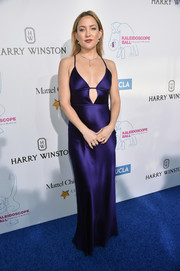 Kate Hudson flaunted major cleavage at the Kaleidoscope Ball in a slinky Amanda Wakeley slip dress in a gorgeous shade of violet.