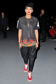 Cassie Ventura kept her look casual in sneakers and a floral and star print T-shirt.