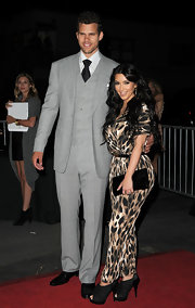Kris supported Kim at the launch of her clothing collection in a three-piece light gray suit.