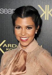 Kourtney Kardashian finished off her schoolgirl chic ensemble with ultra lush and full lashes.