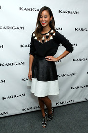 Jamie Chung was monochrome-chic at the Karigam fashion show in a black Essentiel sweater with a sheer, geometric-detailed yoke.